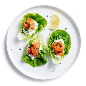 Smoked Salmon and horseradish cream little gem lettuce cups on white
